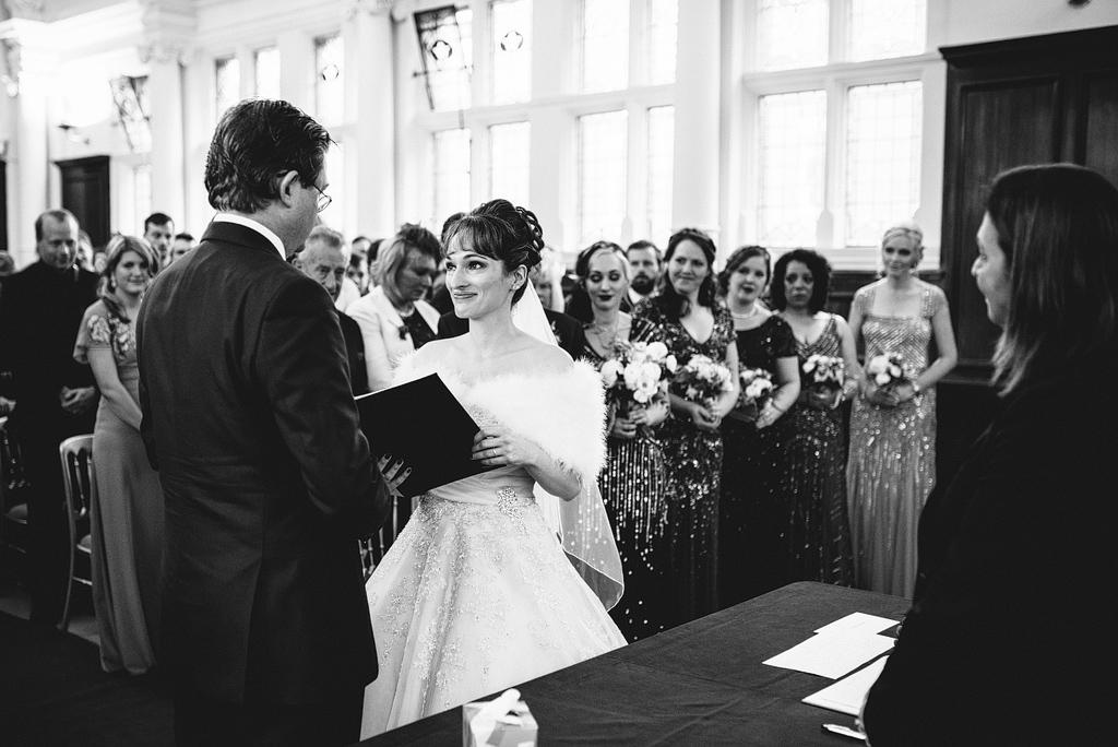Bride reading vows at wedding ceremony