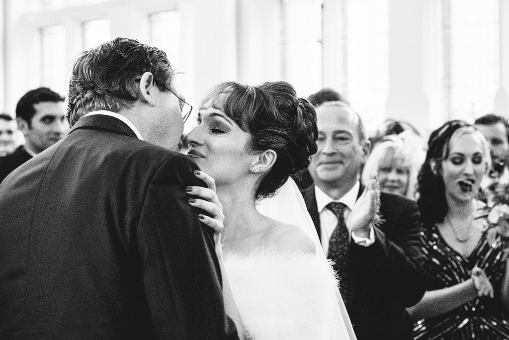 Bride and groom sharing first kiss