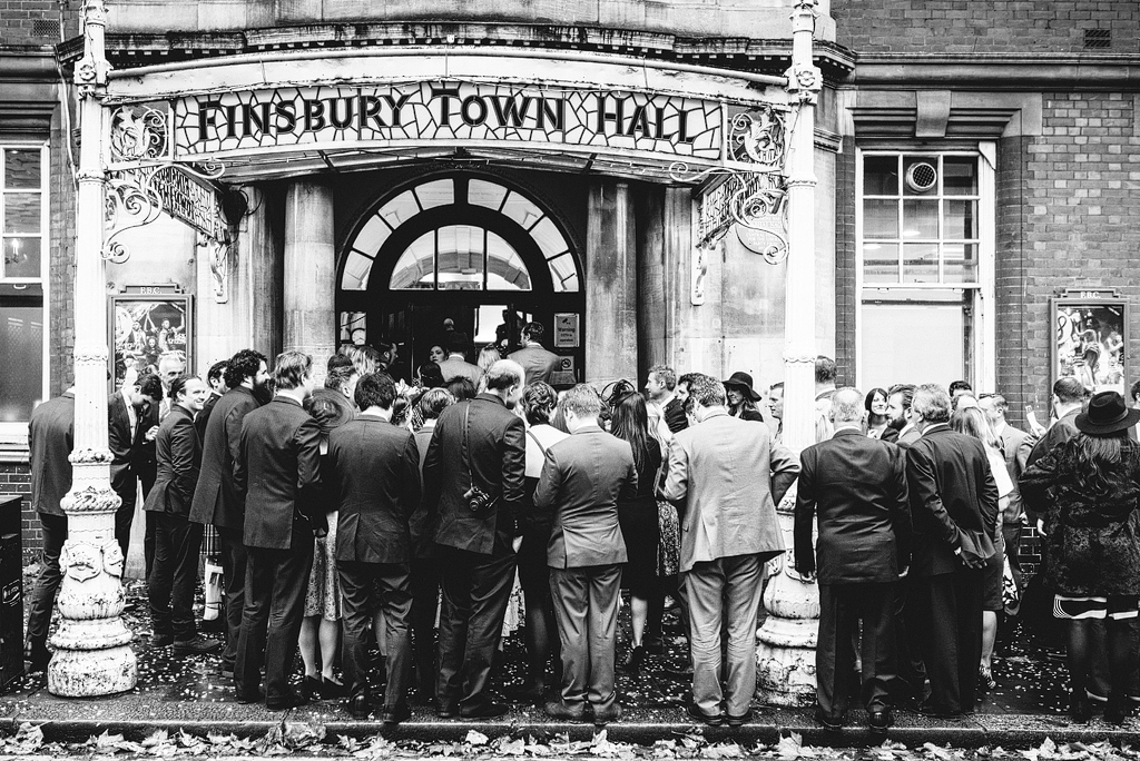 Wedding guests waiting outside Finsbury Town Hall
