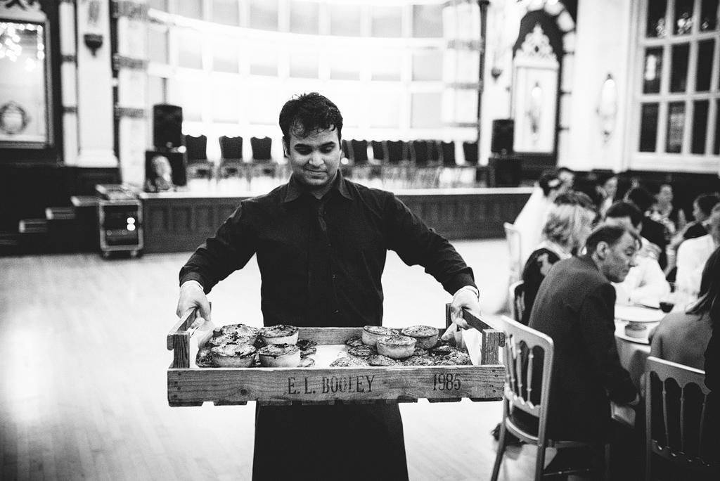 Waiter holding tray of food