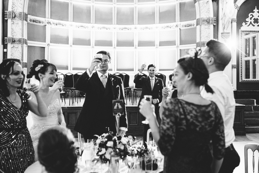 Wedding guests standing to toast