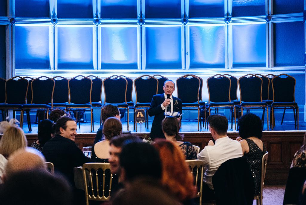 Man giving speech at wedding reception