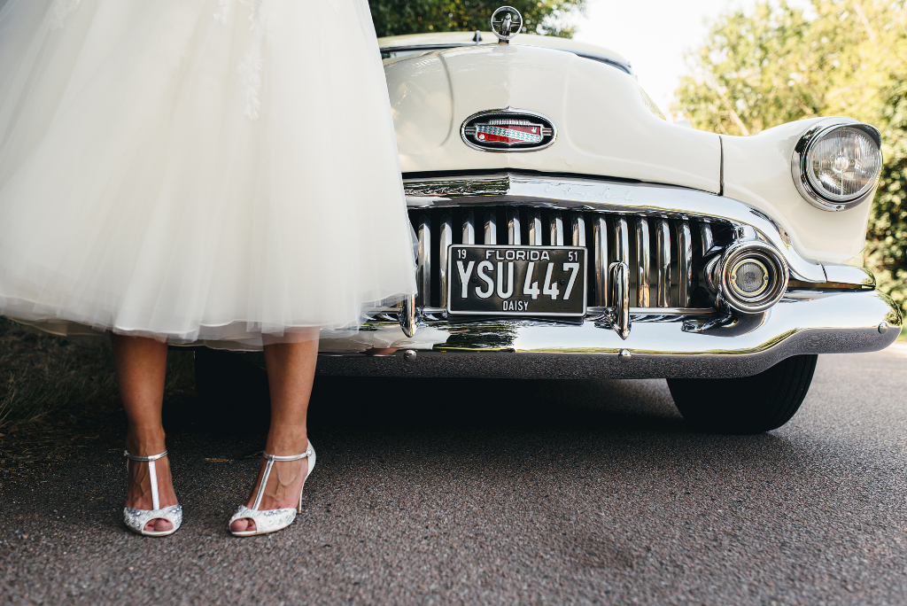 Bride's feet and front of wedding cae
