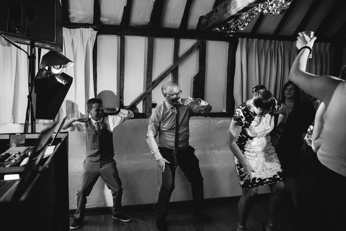 Black and white, guests dancing silly at wedding reception