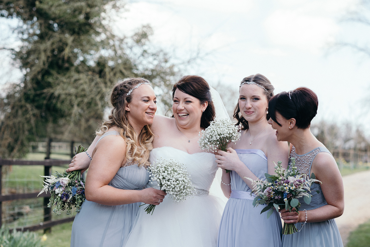 Bride laughing with bridal party outside