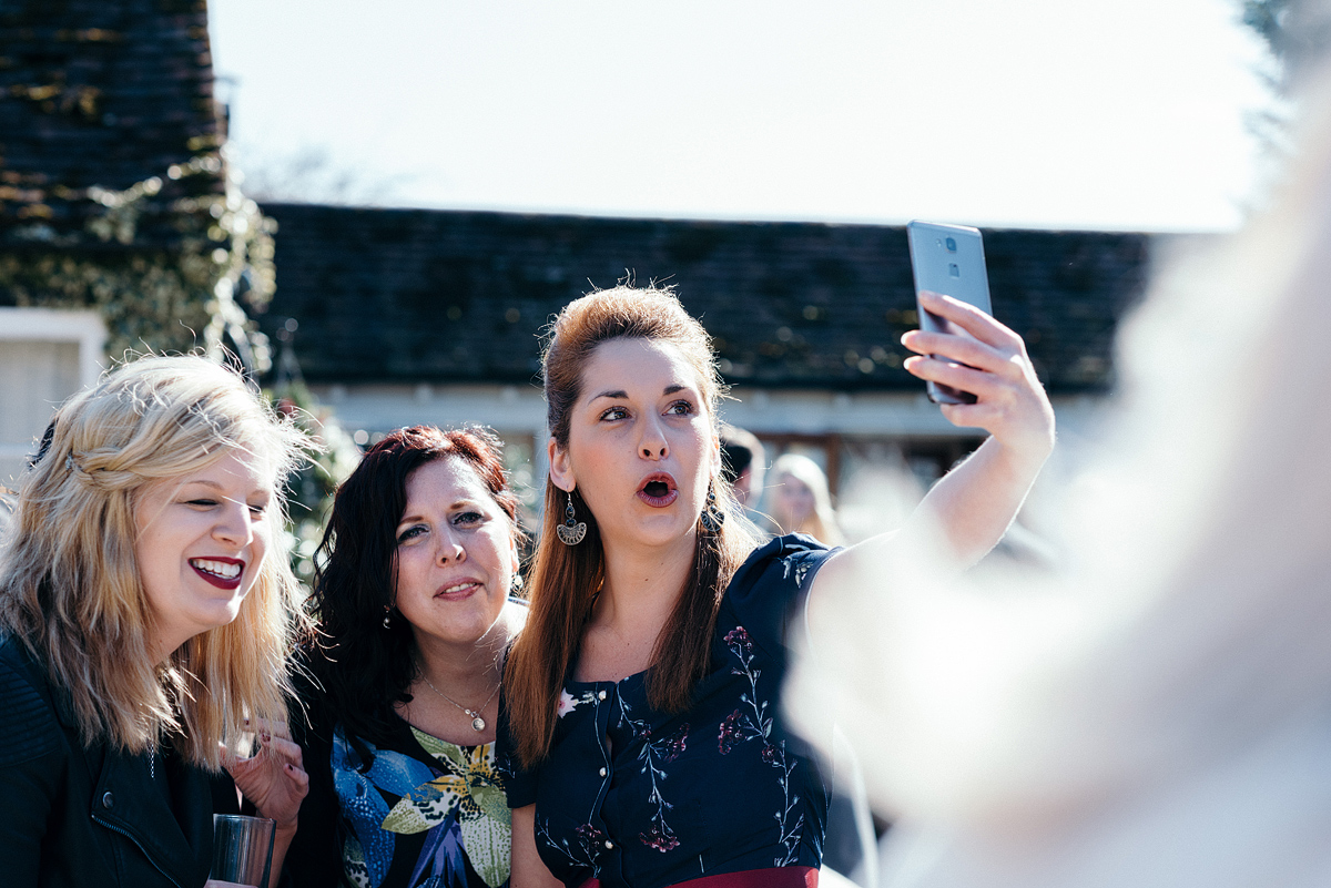 Three female guests taking a selfie outside