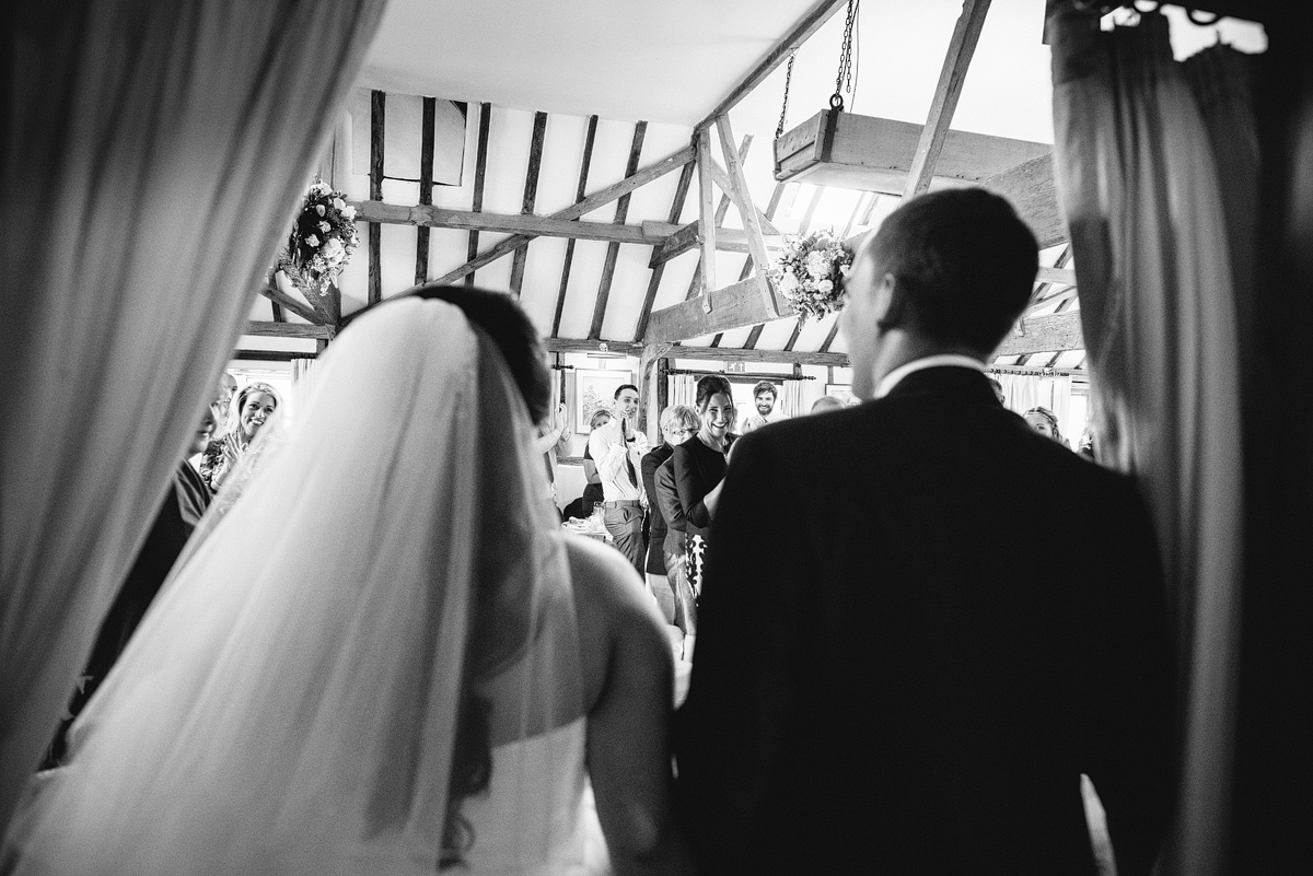 Bride and groom entering reception together