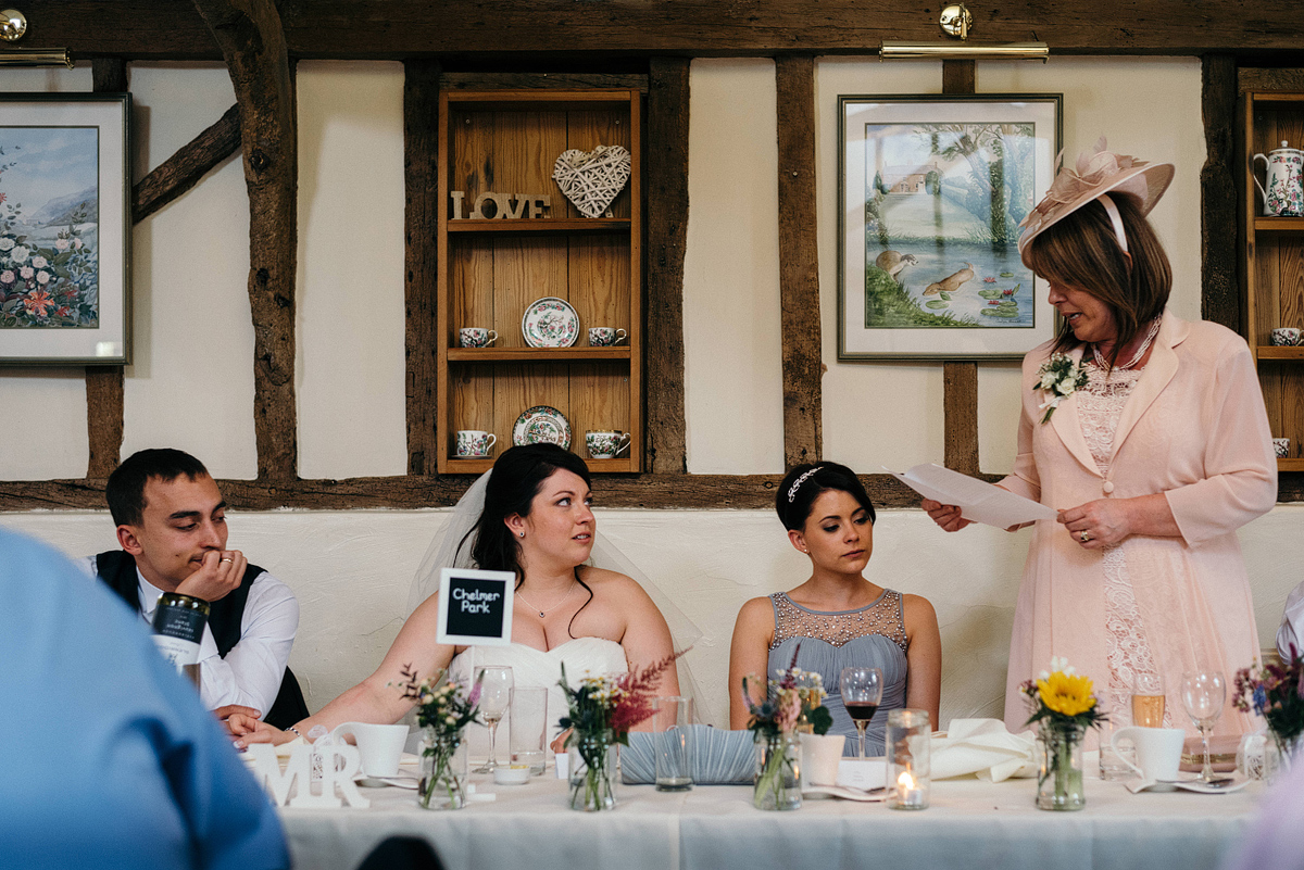 Mother of bride giving wedding speech at table