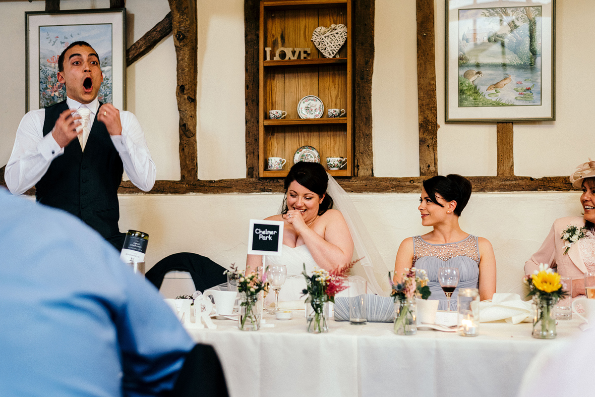 Shocked face on groom as bride laughs