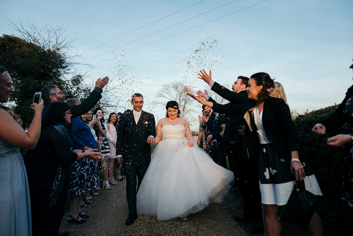 Confetti thrown over bride and groom
