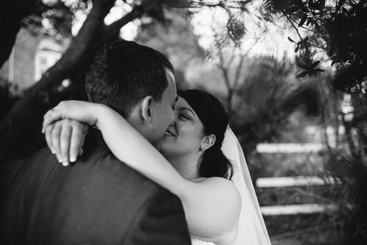 Bride and groom in loving embrace about to kiss
