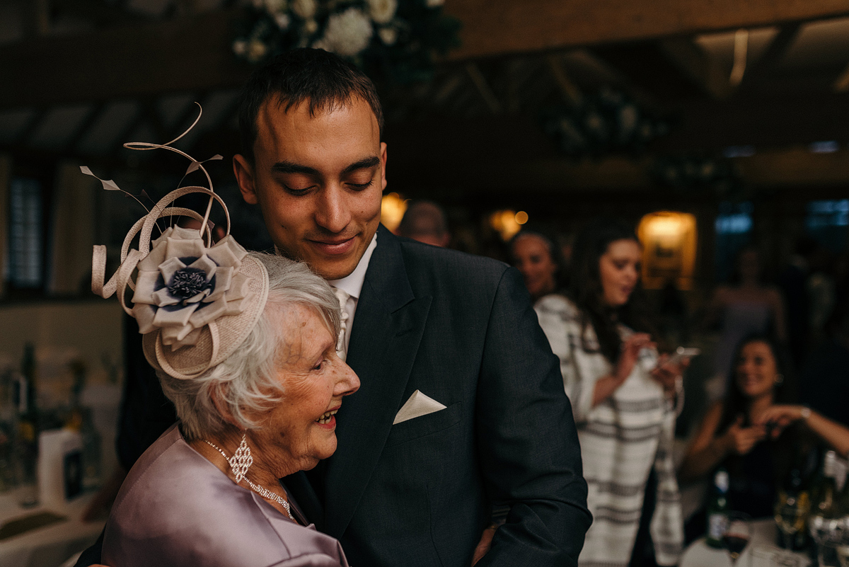 Groom and older woman smiling while dancing