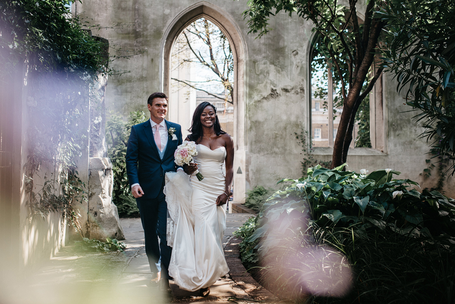 Bride and groom take their fist walk as a couple